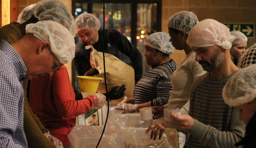 Feed the Hungry food package event with Bishop Karowei